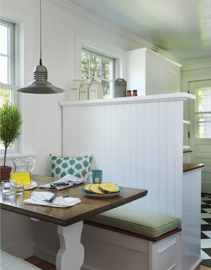 A breakfast nook marries a traditional cottage feel (beadboard panel and ceiling) with colorful accents (punchy throw pillow pattern and teal tableware).: Dining Room, Beach Style, Kitchen Design, House Idea, Half Wall