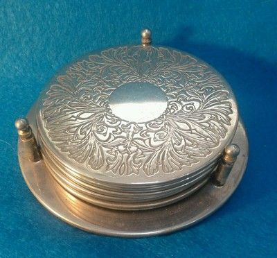 Silver Plate Coasters with Stand I still have these, a gift for our silver Anniversary, 45yrs ago.