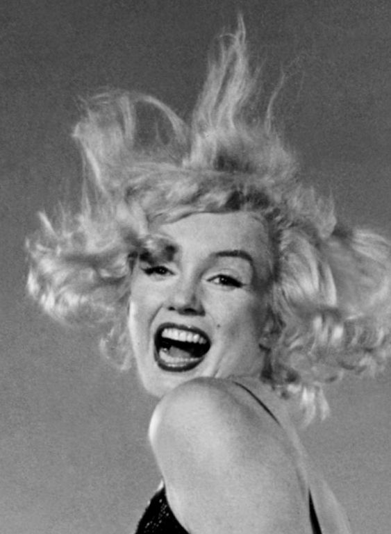 """Close-up of Marilyn Monroe during a photo session with Philippe Halsman for the cover of LIFE Magazine. (1959) (Believe this is part of his """"Jump"""" series.)"""