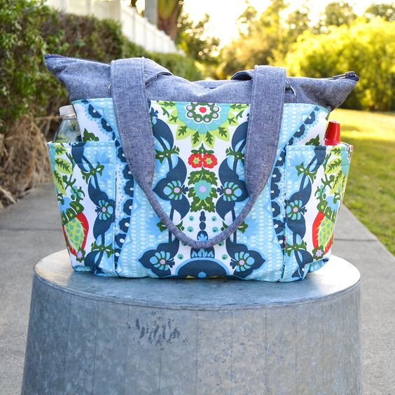 DIY diaper bag tutorial with side pockets. The perfect bag for moms on the go! Click for the free pattern and step by step instructions.
