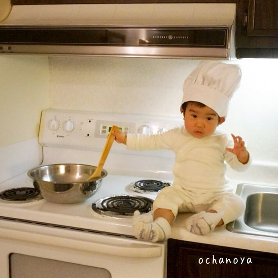 Baby son in the kitchen. Baby chef. Baby memory photography. Birthday photo. Theme photo.