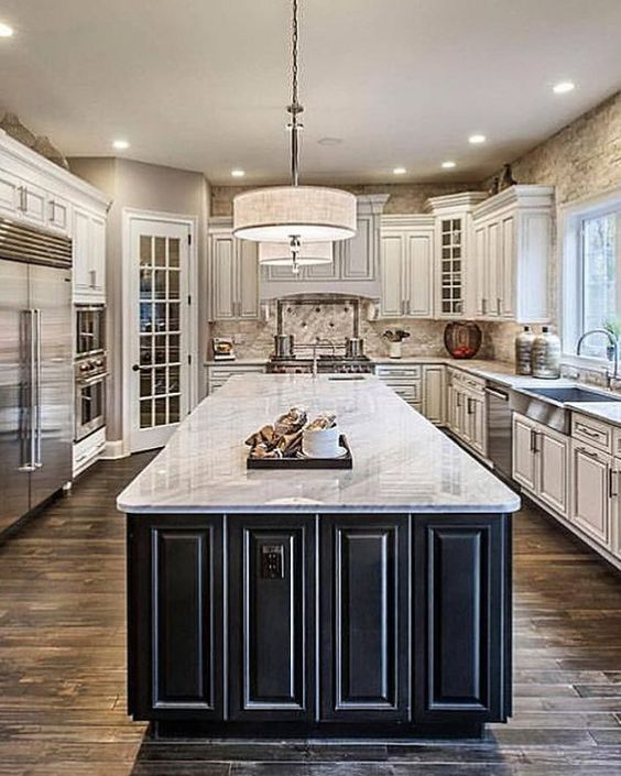 White Kitchen Remodels Are A Classic Look But Adding A Dark Island Takes It Up A Notch Kitchen Design Luxury Kitchens Kitchen Remodel