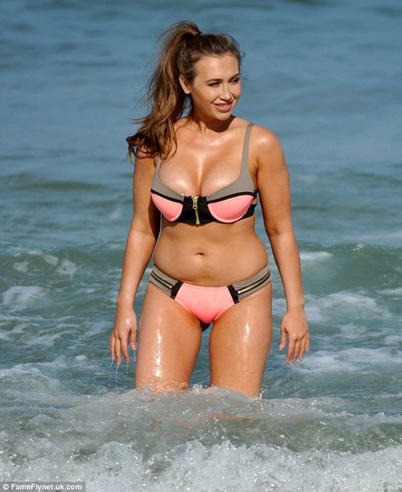 Plenty to smile about: Splashing around in the surf, Lauren had good cause to be pleased w...