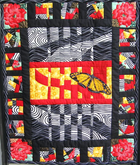 """""""Butterfly"""" is mostly hand quilted...http://www.youtube.com/watch?v=ycXv3TDlQnE"""