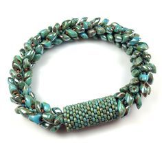 Kumihimo Bracelet with Long Magatamas & C-Lon Tex 400 Bead Cord & Peyote Stitch Sleeves