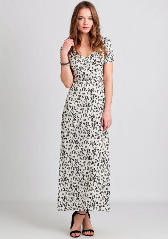 This lovely white maxi dress is complete with an allover black feather print.