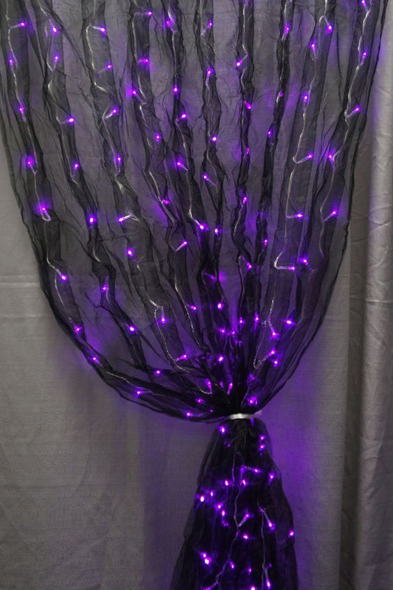 black fabric sash and purple led lights together makes for one really cool decoration black fabric lighting