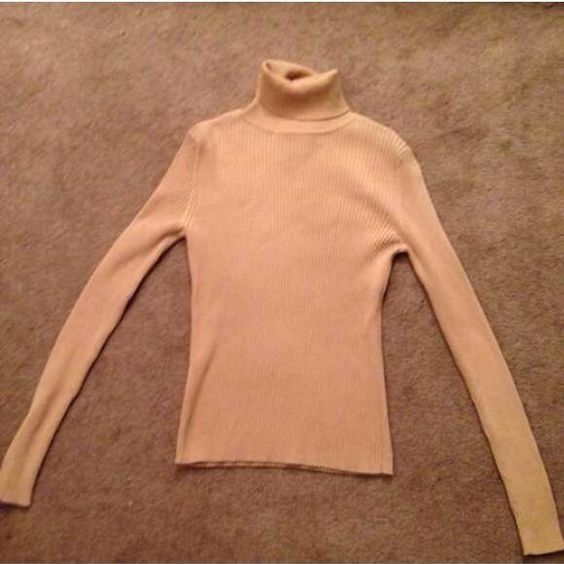Camel turtleneck! This camel turtleneck is comfy, warm, & stylish. Goes nice with slacks or jeans. With winter around the corner it's good to dress warm. Great condition. Bundle to save on shipping. NO TRADES, sorry! Express Sweaters Cowl & Turtlenecks