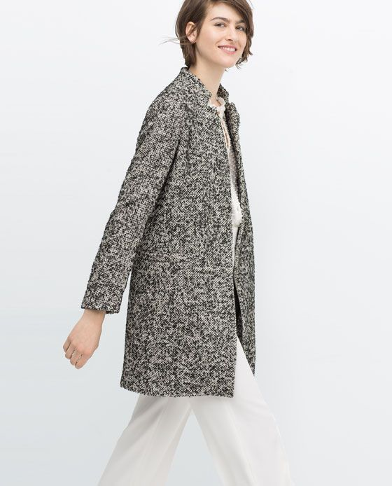 Vince Camuto Petite Faux Leather Trimmed Belted Boucle Wool Coat - Black P/L. Vince Camuto combines textile, texture and trim in this super trendy medium-weight petite wool coat; throw it on-and-go for a last layer oh-so chic statement piece. more.