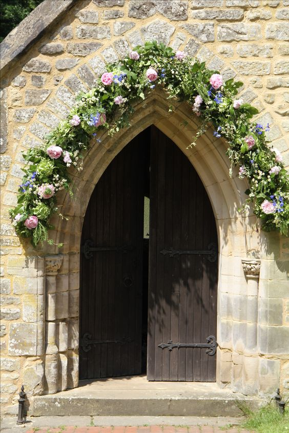 English church portal decorated for a wedding :) Might be a bit much too much work, but would love the church doors decorated.