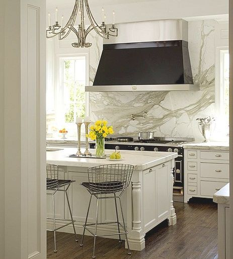 Carrara Marble will look the best with a plain white like BM OC-65 Chantilly Lace or Decorator White (below) or even a white with a blue undertone like Pure White OC-64