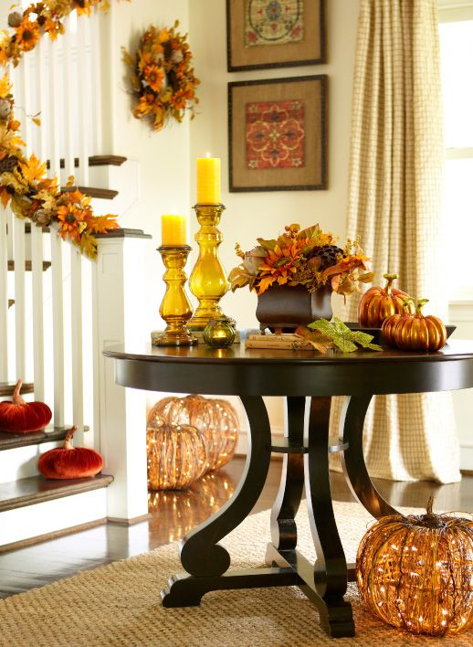Rubbed black round dining table foyer tables pumpkins for Pictures of fall table decorations