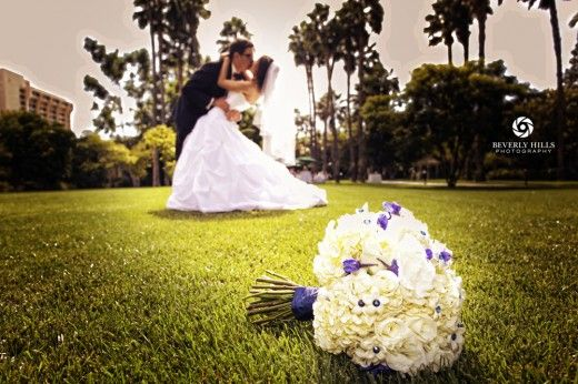 maybe all the bouquets on the grass... and our little dog checking them out...us in the background