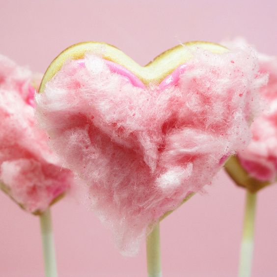 the decorated cookie's cotton candy cookie pops...adorable!