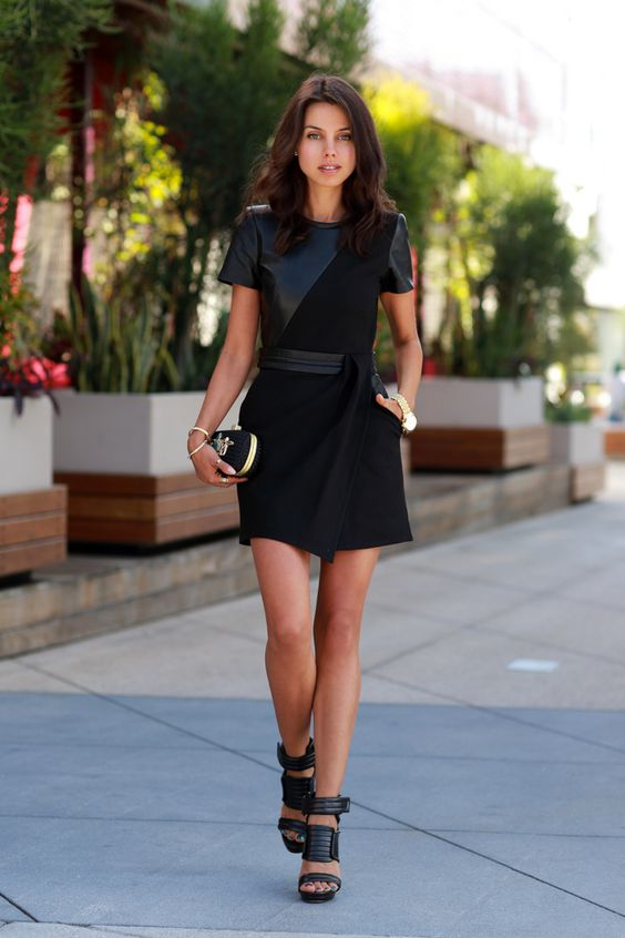 leather dress with elegant clutch: