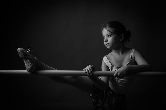 Tiny Dancer - Young ballerina on the barre before her dance intensive.