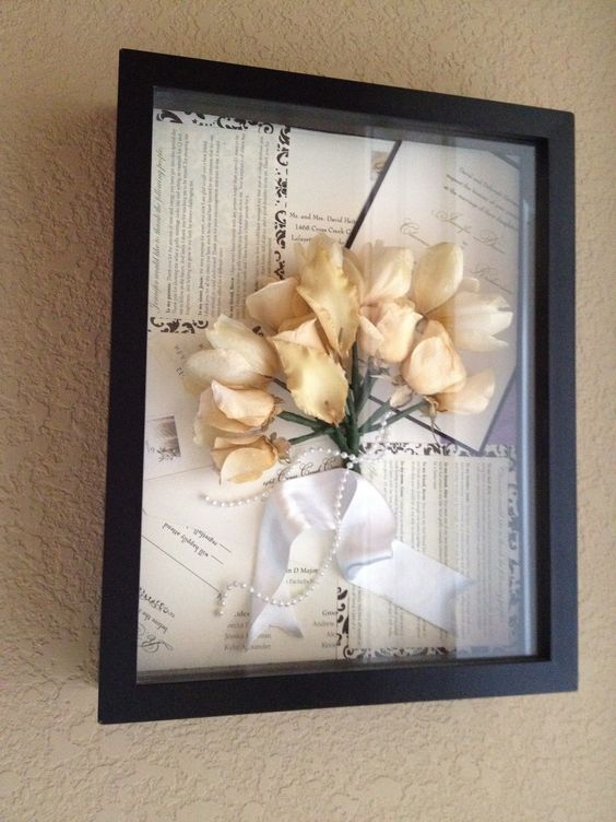 Wedding flowers, invitations, announcements in shadow box.