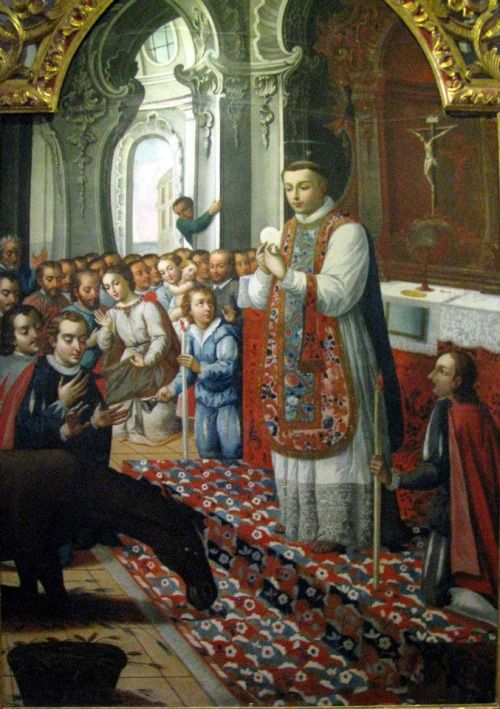 St. Anthony and the Eucharistic miracle with the donkey. Painting is at the Convent of St. Francis,  in Quito, Ecuador.