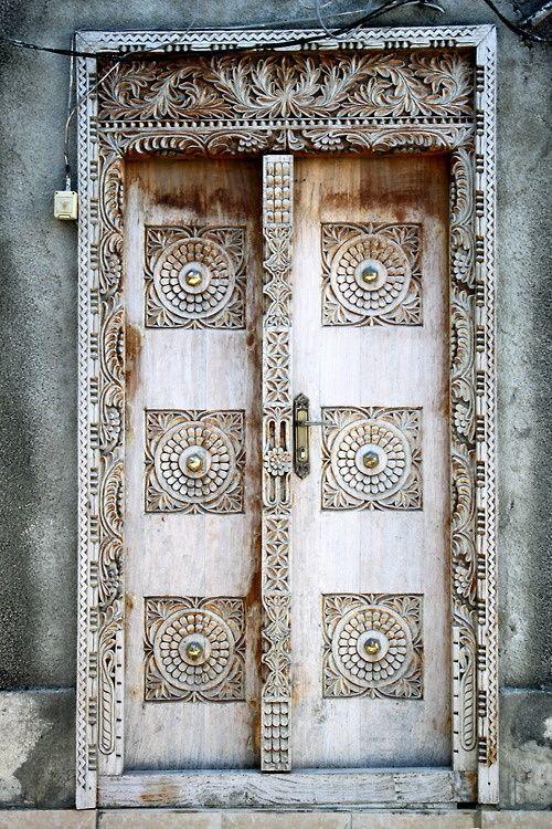 Door with carved decoration (Universe Mininga)