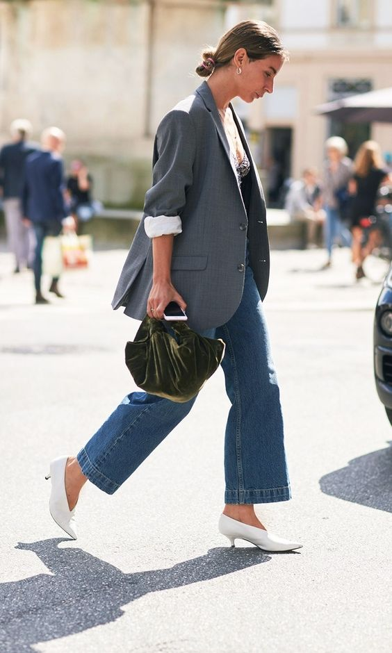Copenhagen Fashion Week Street Style 2017: low bun, grey blazer with white button down, flared cropped jeans, and a white stiletto