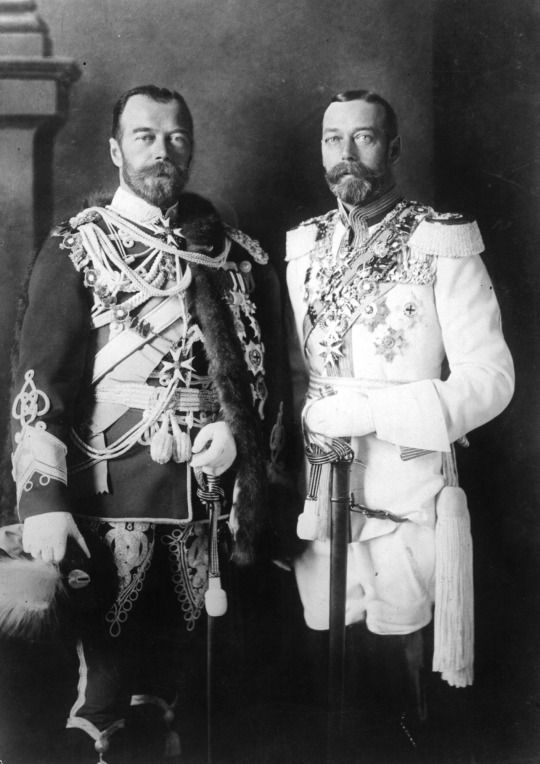Tsar Nicholas II of Russia with his physically similar cousin, King George V of the United Kingdom , in German military uniforms in Berlin before the war .: