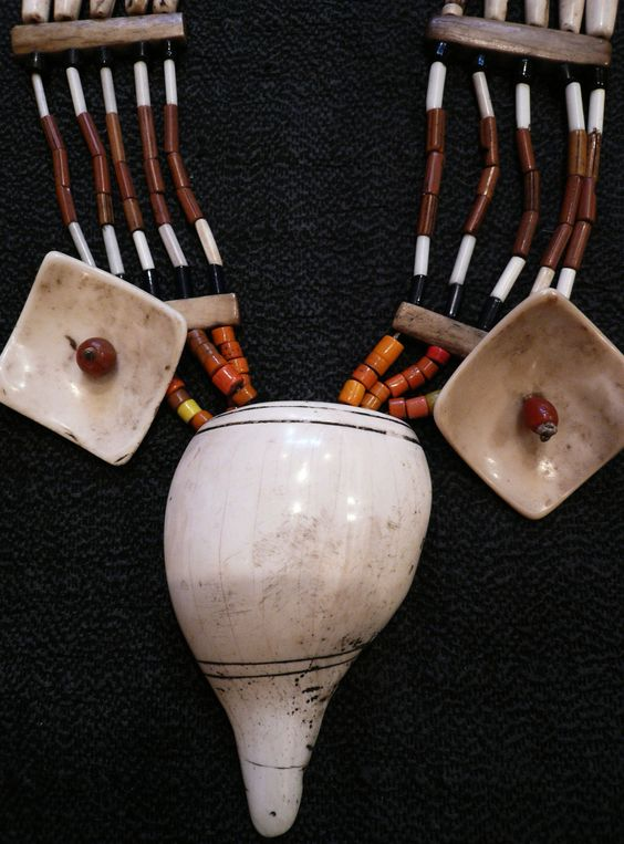 Carved conch shell, bone, carnelian and glass beads. length 48 cm  A15537 Glass trade beads and twine necklace   Nagalandearly 20th century