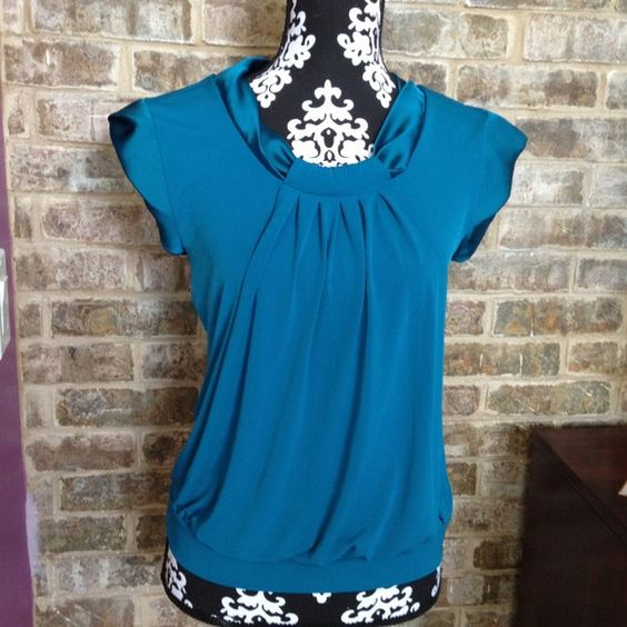 Nice stretchy  top size Small . Tops