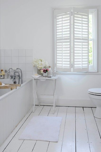 White painted wooden floor in bathroom