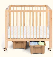 Community Playthings is a brand I love. You see their tables and chairs in a lot of private school classrooms as they really understand spacial needs for caregivers.   They also apparently have a fabulous mini crib. You can buy it with/out the telescoping side that will save your back.