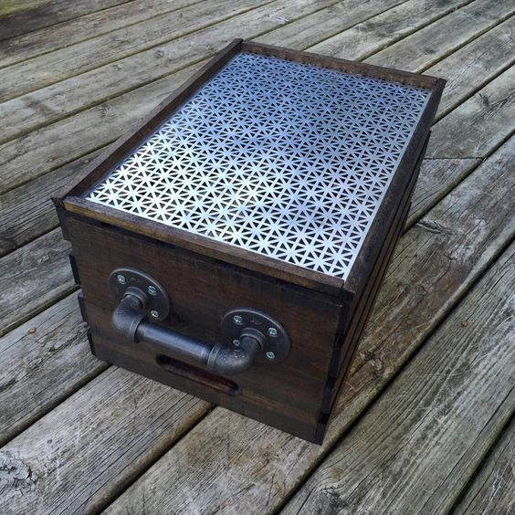 Small pallet crate end table with a metal top and two black iron handles. #RusticTwist