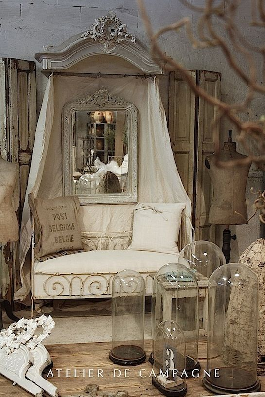 Would make a great reading nook! Atelier de Campagne, a dynamic trio of antiques dealers.  French iron day bed Cloche Half-Tester
