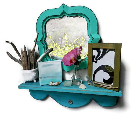 Hand paint a vintage mirror in a lovely 'Sea breeze' and hang above a shelf full of goodies !
