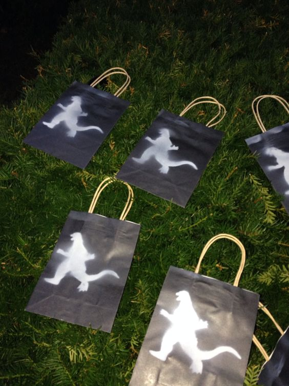 Godzilla goodie bags - black bags with spray painted stencil.