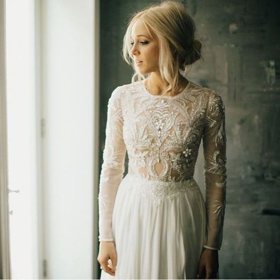 Stunning long sleeve wedding dress ideas. We love this bohemian look!