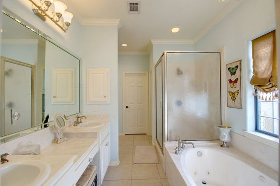 Innovative The Master Bathroom Offers A Dual Sink Vanity With Knee Space Stained