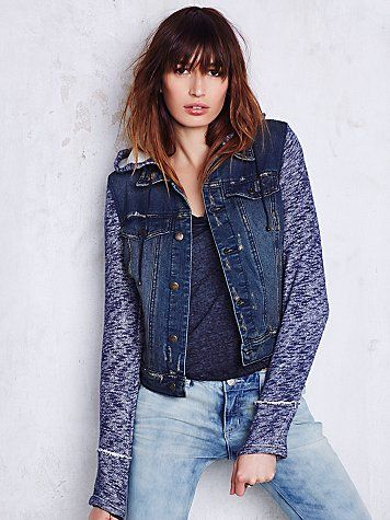 Knit Hooded Denim Jacket | Distressed denim jacket with attached knit sleeves and hood. Button front closure and two front slit pockets. All over roughed look. A cool piece to add a tomboy edge to any look.