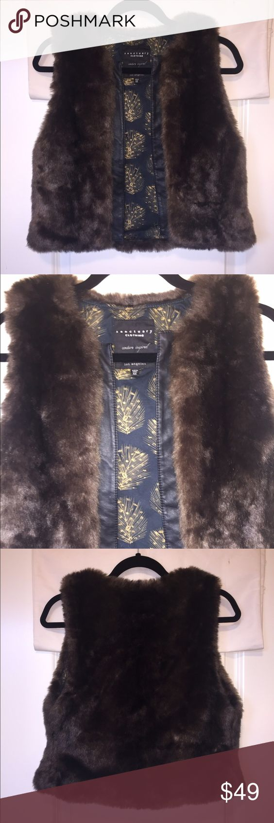 "Sanctuary Faux Fur Vest Beautiful Sanctuary faux fur vest with leather trim. Like new. Only worn once. Pretty lining. 74% acrylic/26% polyester. 20"" length. Size XS. Sanctuary Jackets & Coats Vests"