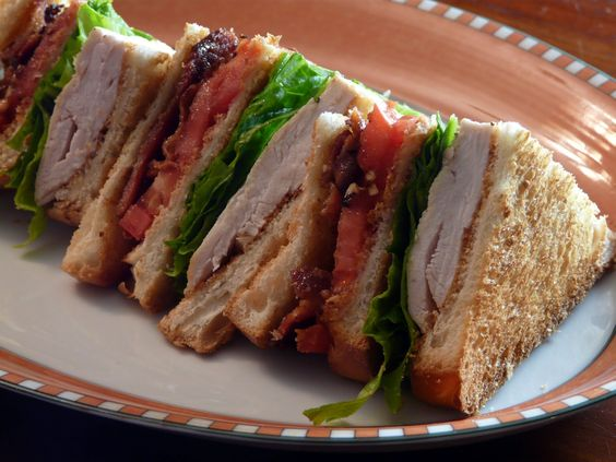 Toasted Clubhouse Sandwich. Roasted Chicken, Bacon, Lettuce and Tomato