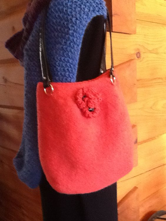 Felted Spring purse with leather handles and three flowers as accents.