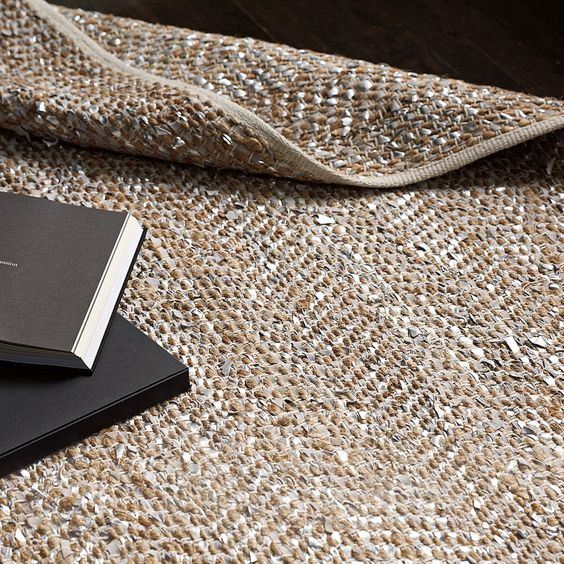 A rug of metallic suede and hemp.  Genius.  Wish I'd thought of it.