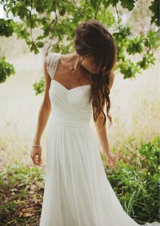 Beautiful chic wedding dress with lace capped sleeves. Classic & feminine. Her hair is amazing too!