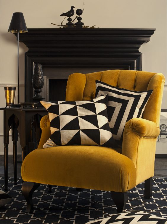 Coveting this amazing Gold chair - works so well with monochrome cushions