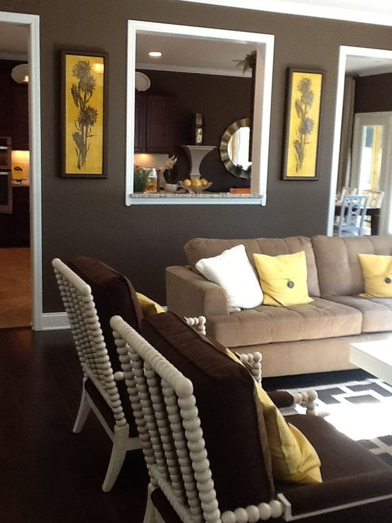 Brown, Yellow, Geometric Pattern, white, living / family room decor. Couch, chairs lovely Designer Unknown - Photo Courtesy of Dana Guidera Author of Seven Poems from Life