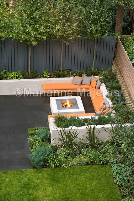 Chill out garden contemporary seating area with firepit for Garden designs seating areas