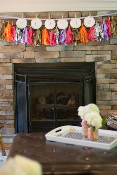Tissue tassel garland at baby shower can later be hung in nursery for a fun pop of color!