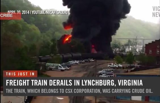 A CSX Corp. train carrying crude oil derailed in downtown Lynchburg, Virginia on Wednesday. Approximately 12 to 14 tanker cars were involved in the accident, with several of the cars bursting into flames, dumping oil into the James River.