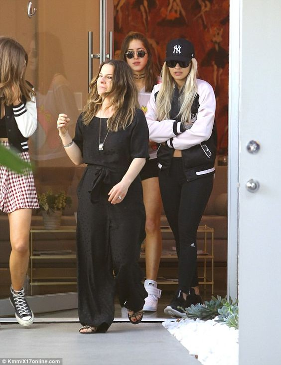 Here come the girls: Rita was surrounded by her girl pals as they made their way to the sa...
