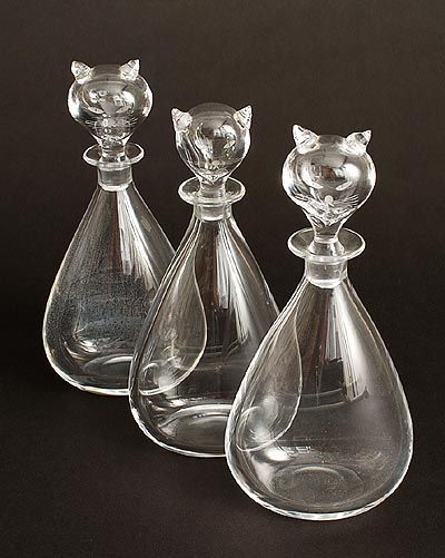 Three decanters with stoppers shaped like cat's heads design Sven Palmqvist 1 960 executed by Orrefors / Sweden: