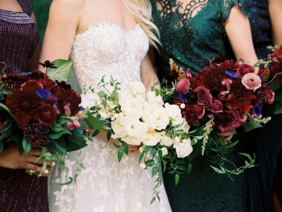 burgundy-bridesmaids-bouquet http://itgirlweddings.com/ombre-flower-wall-wedding/