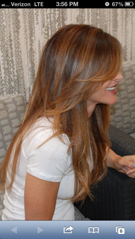 """Says """"great long layers, tapered"""" looks like it isn't layered in the back, which I like. I like the long bang like layers in the front."""